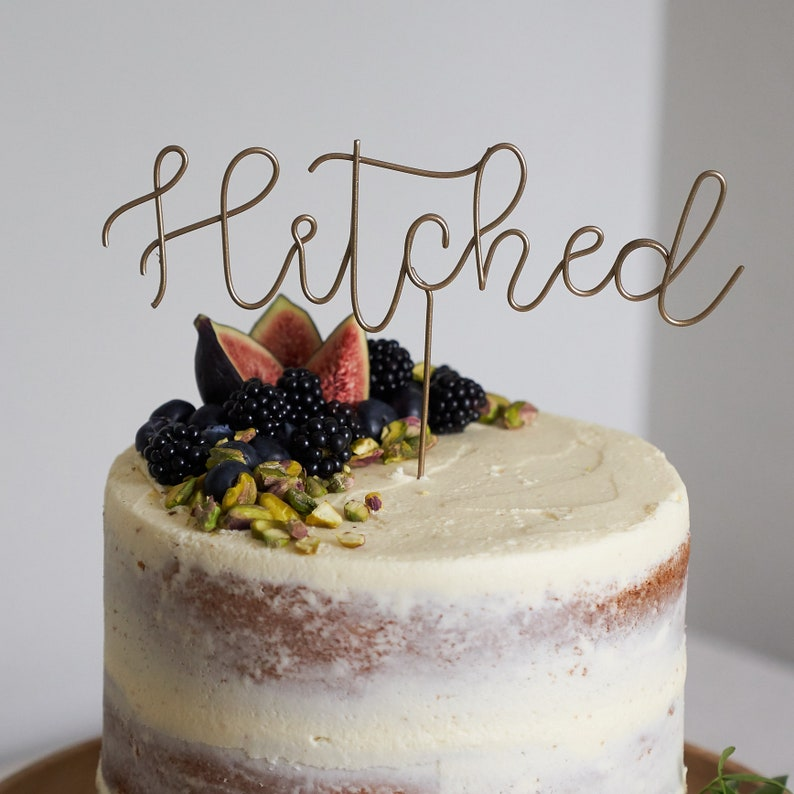 Hitched Wedding Cake Topper image 0