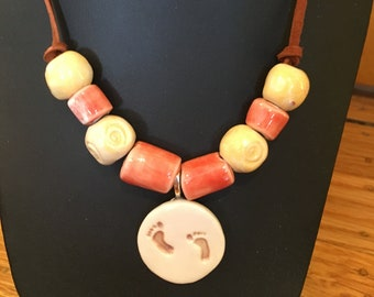 Handmade, Brown Leather and Porcelain, Beaded Necklace, and Pendant with Hand-stamped Red Barefoot motif for those avid runners!