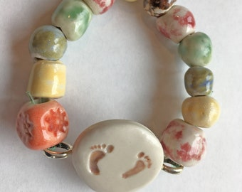 Multi-colored Handmade Porcelain Beaded Bracelet and Pendant with Hand-stamped Red Barefoot motif for those avid runners!
