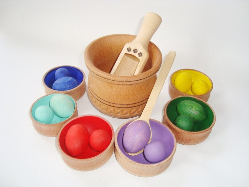 Sorting toy balls and eggs. Wood rainbow balls. Minimalist Toddler Toys.