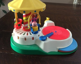 Vintage Fisher Price Little People Play a Tune Carousel