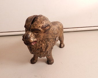 vintage cast iron lion still bank gold tone