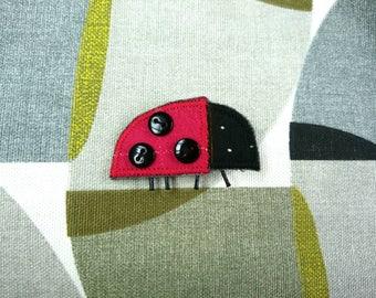 Ladybird textile brooch