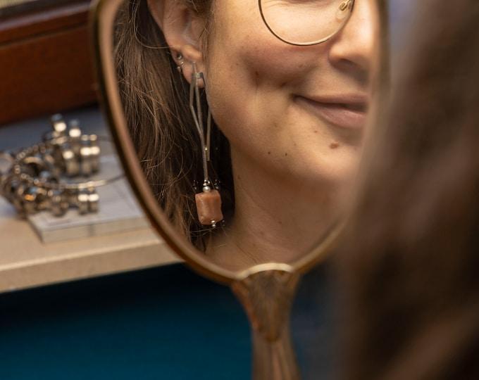 OPEN KITE earrings.