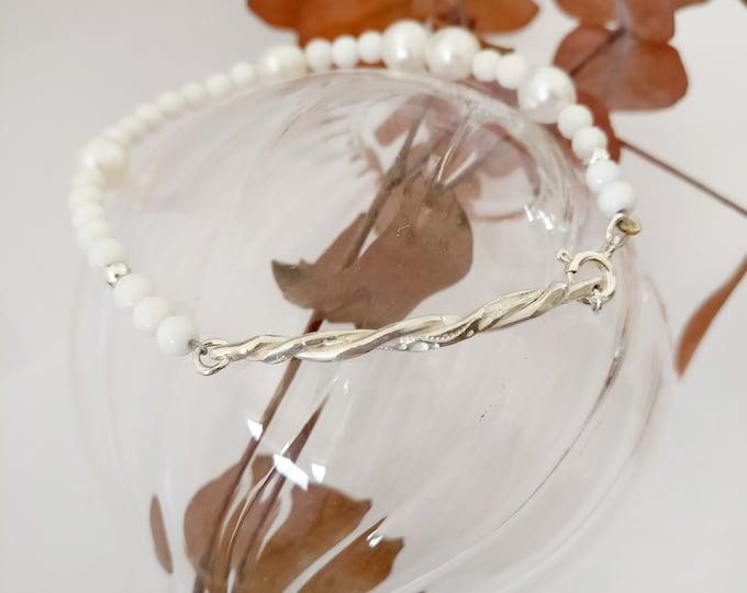 Silver TWIST bracelet.