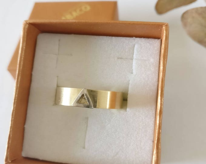 ONE of a kind ring with triangle.