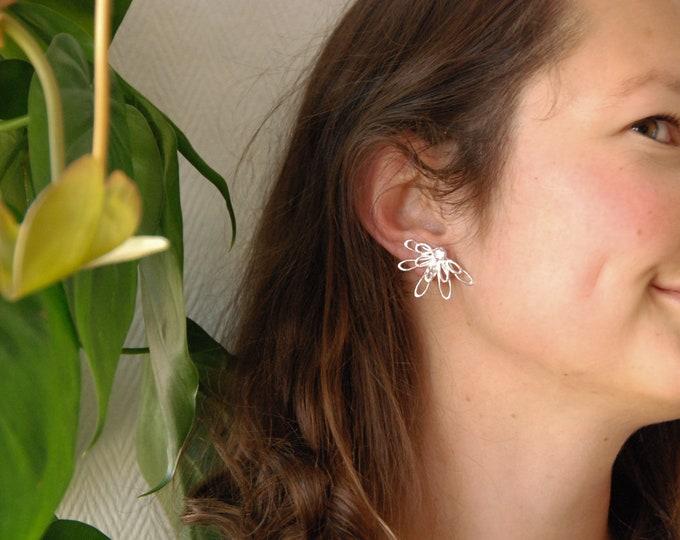 Silver LAUREN earring.