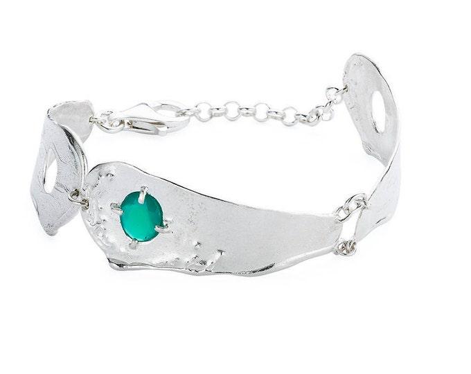 Silver SEBA bracelet.