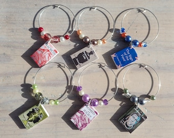 A level book themed wine charms, An Inspector Calls, A Christmas Carol, Jekyll and Hyde, Macbeth, Romeo and Juliet, Sign of the Four