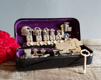 Rotary Sewing Machine Attachments in Original Purple Velvet Lined Box Circa 1950