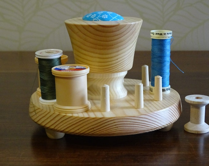 Cotton reel holder with pincushion