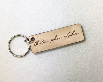 Phi Kappa Theta Leatherette Oval Keychain