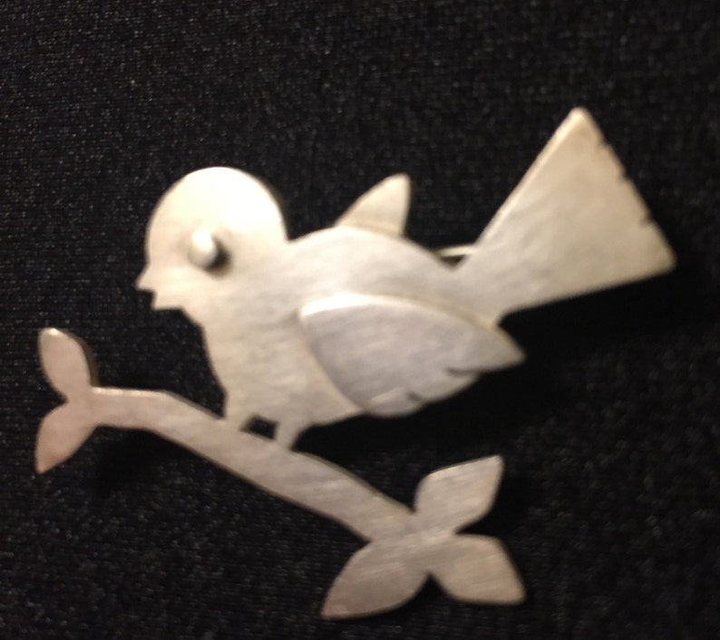 sterling silver bird perched on a branch brooch