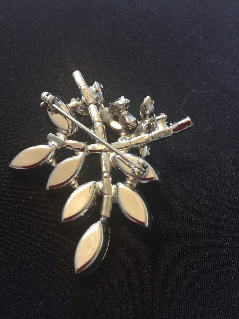 Vintage clear and sapphire rhinestone flower and leaves brooch