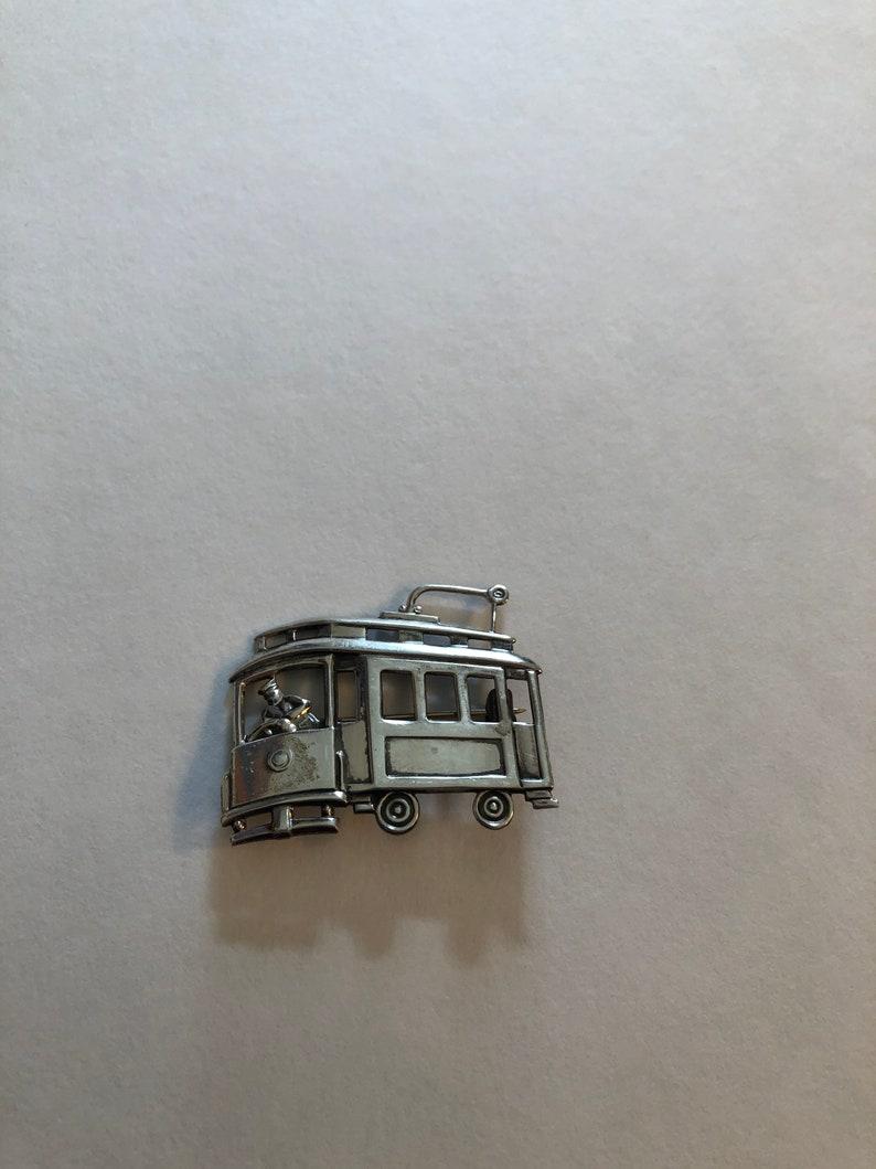 Vintage sterling silver trolley car brooch signed LS