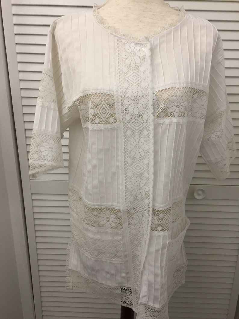 White cotton blend tunic bathing suit cover blouse lace trim Like new see through lace top for many different uses Boho to dressy summer top