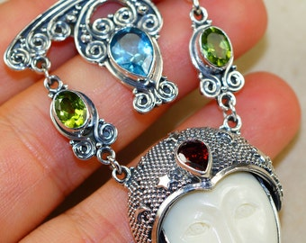 Carved Ox Bone Face Goddess with Blue Topaz, Garnet and Peridot & 925 Sterling Silver Pendant
