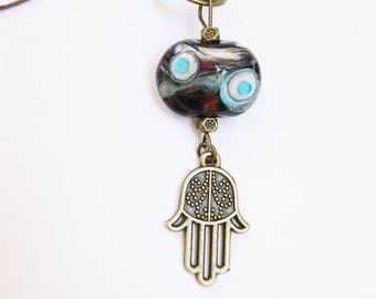 Necklace with a glass bead pendant, Fatima's hand, Brown, turquoise, white, antique bronze