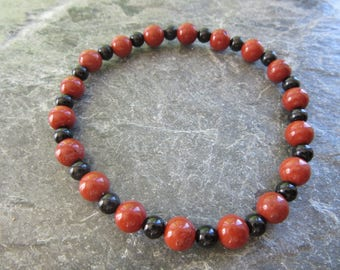 The red jasper and tourmaline bracelet! Stretch bracelet natural red jasper 6mm and black tourmaline 4mm Reiki infused