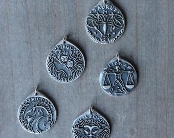 Zodiac signs fine silver pendant