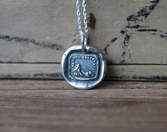 Calm in the storms-Cliff in a storm wax seal oxidized fine silver charm