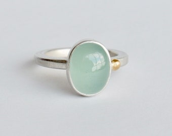Ellipse silver ring with aquamarine and a 18k gold drop