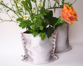 handmade vase of concrete textile, sturdy flower vase appearing like textil, shabby look with bright coloured seam