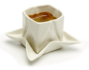 Origami espresso cup made of porcelain including saucer, with folds and kinks like folded paper