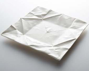 Origami porcelain plate, handmade, as platter or dinner dish in the unique design of folded paper