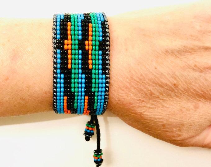 Bracelet Carlos Cruz Diez. (Turquoise)  Handmade with Czech beads on a wax rope by venezuelan artist.