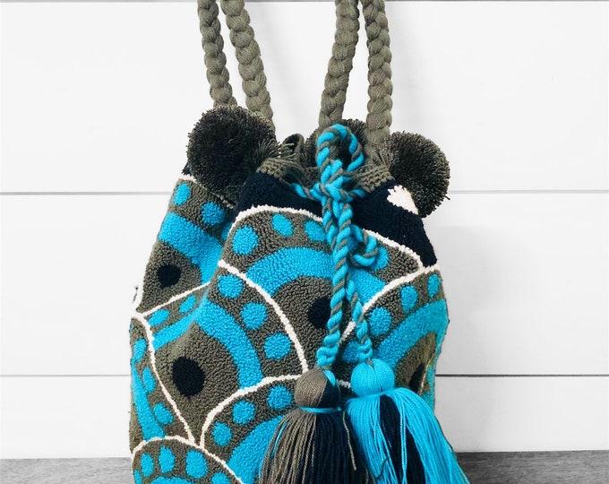 Unique Design. Wayuu Mochila with PonPons  handmade in La Guajira Colombia.