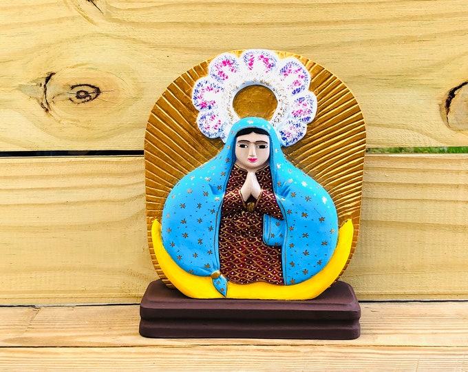 Hand painted by Venezuelan artist Virgen de la Milagrosa. From Mérida Venezuela