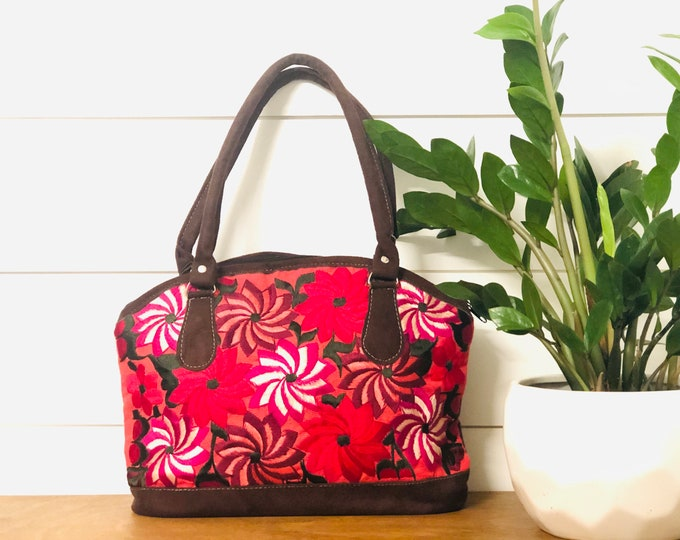 Original  flowers   bag is constructed with Guatemalan Huipil (hand embroidered fabric), and faux leather.