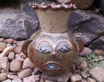 Glazed ceramic face jug vase