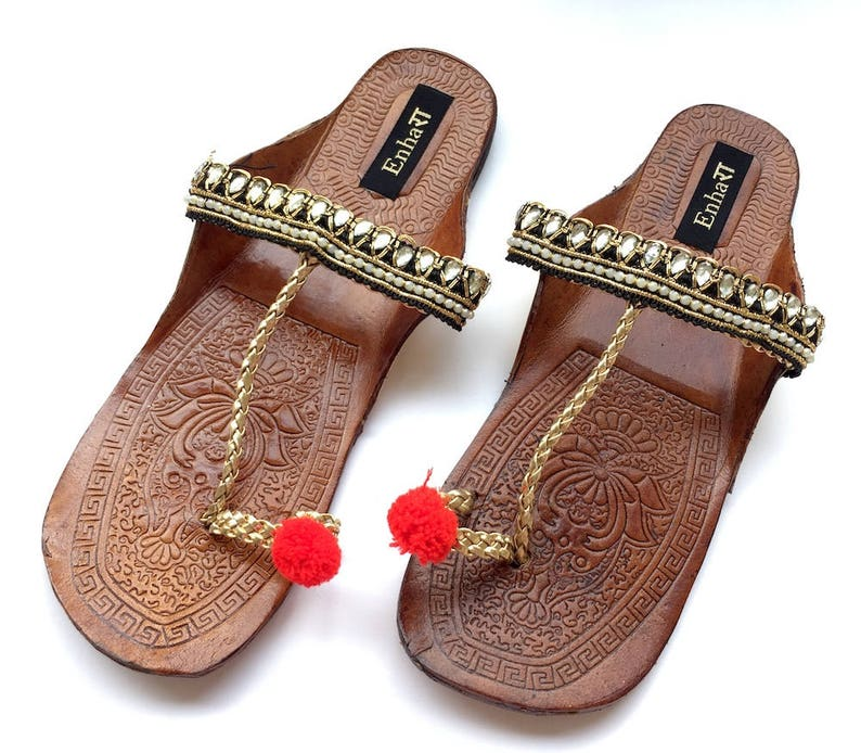 90b4a61477168 Black   Gold Kolhapuri Chappals Embellished with Red Balls and