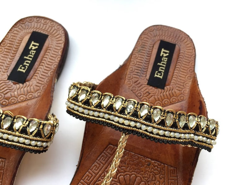fd1f1cbcb8db3 Black   Gold Kolhapuri Chappals Embellished with Red Balls and