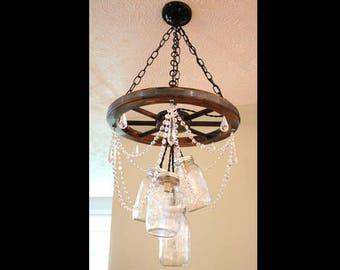 Mason jar chandelier etsy wagon wheel mason jar chandelier with crystal 5 jar aloadofball Gallery