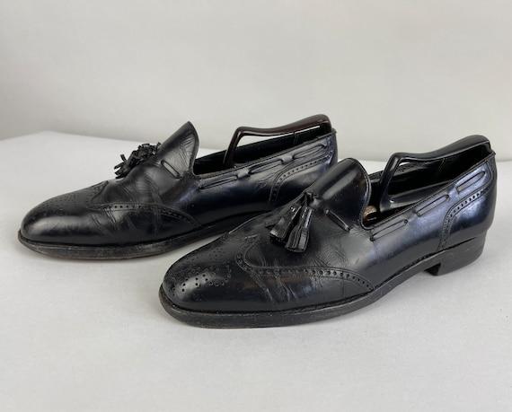 1950s Fancy Florsheim Loafers | Vintage 50s Black Wingtip Leather Florsheim Imperial Lounge Slip-On Shoes with Tassels & Broguing | Size 9.5