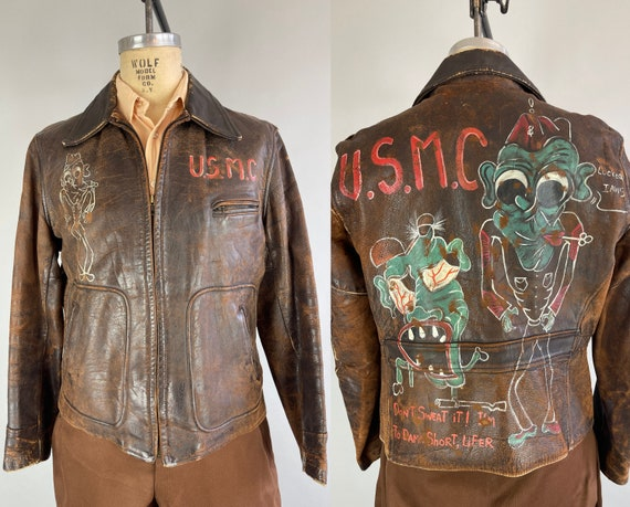 1940s USMC Locked Jaws Jacket | Vintage 40s Hickory Brown Leather Hand Painted Characters WWII Belted Back Motorcycle Jacket | Medium/Large