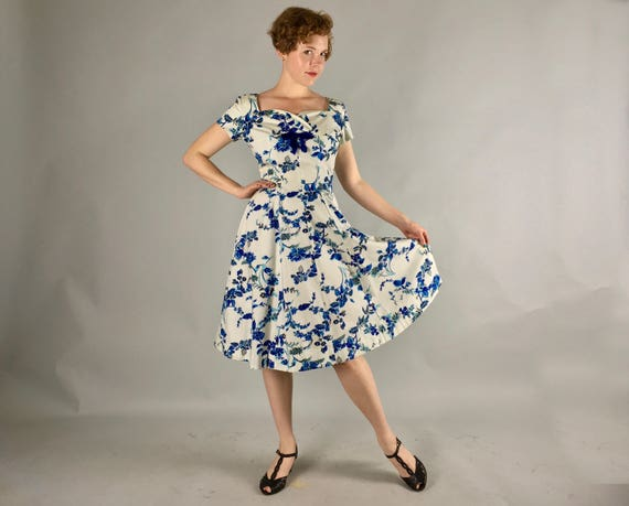 Vintage 1950s Dress   50s Blue and White Floral Cotton Party Dress w/ Full Skirt, Cap Sleeves, Velvet Bows, and Sweetheart Neckline   Medium