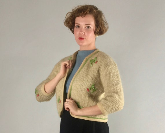 1950s 1960s Bows and Cherries Sweater | Vintage Kitschy 50s 60s Mohair & Wool Cream White Swing Cardigan with Green Velvet Piping | Medium