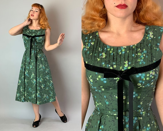 1950s Flirty Floral Day Dress | Vintage 50s Forest Green, Lime and Blue Daisy & Rose Print Cotton Party Frock with Black Velvet Bow | Small