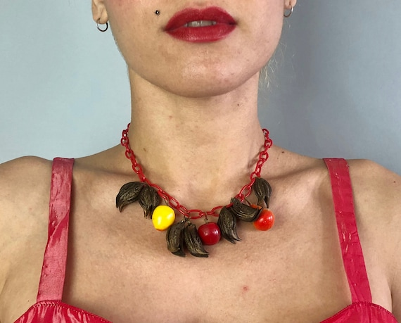 1940s Novelty Charm Necklace | Vintage 40s Red Celluloid Chain with Papier Mache Apples and Pears and Natural Cat's Claw Seed Pods Necklace
