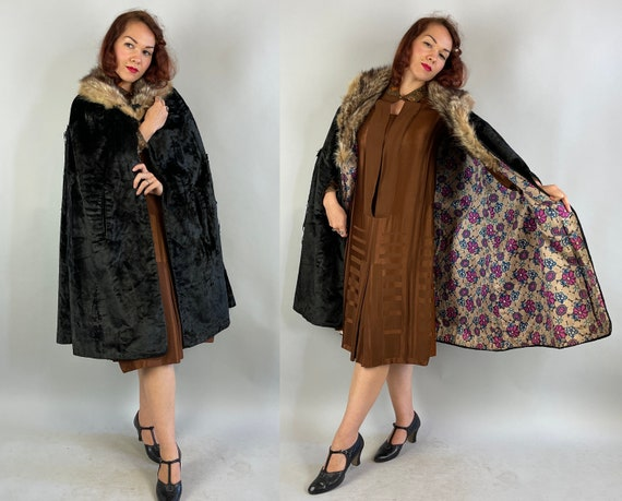 1920s Magnificent Mae's Mysterious Cape | Antique 20s Black Velveteen Opera Cloak Wrap with Raccoon Fur Collar Tassels and Celluloid Clasp