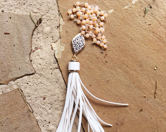 Long Leather White Tassel Necklace with Silver and Gold Connector Pendant on a Peach Beaded Chain