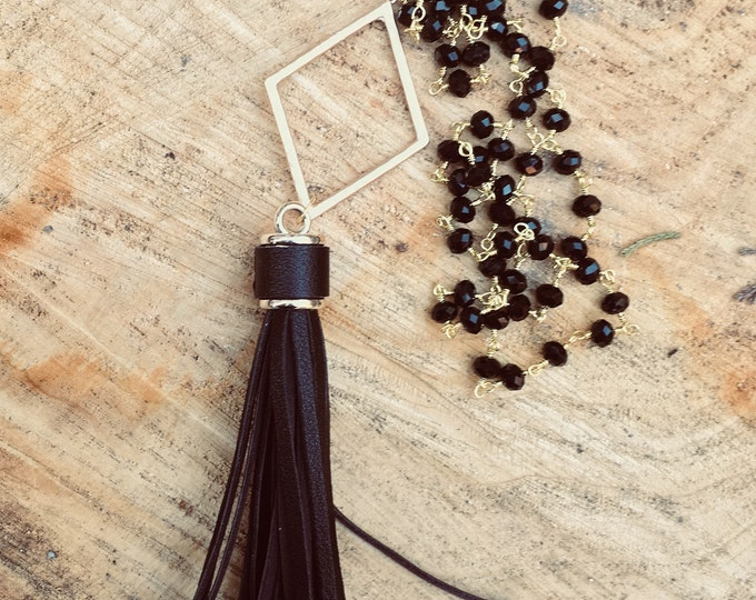 Black Leather Tassel Necklace with a Gold Diamond Pendant on black Beaded Chain