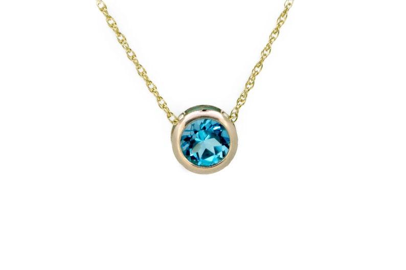 9ct Gold Swiss Blue Topaz Necklace  Gold Birthstone Slider image 0