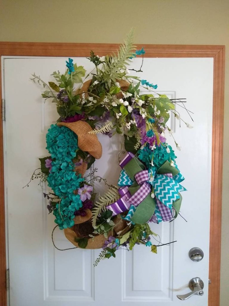 Grapevine wreath with burlap and beautiful turquoise flowers!