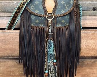 f82cbf575bf0 Fringe Louis Vuitton Turquoise Leopard Bag