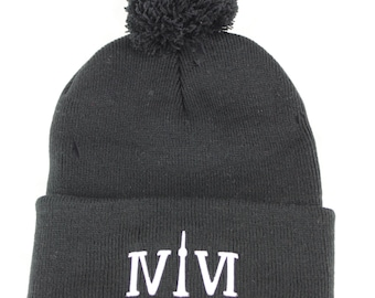 "Black Pom Pom 416 toques. The Roman Numerals Stand For ""416"", with the ""1"" resembling the CN Tower. We Are Toronto Beautiful."